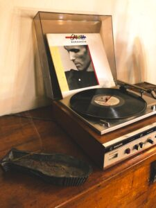 Skipping record player placed on wood